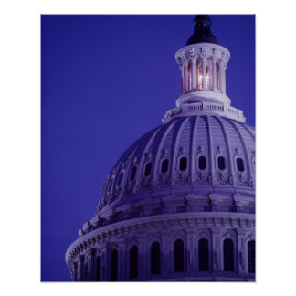 U.S Capitol at dusk with light in dome on Poster