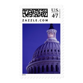 U.S Capitol at dusk with light in dome on Stamp