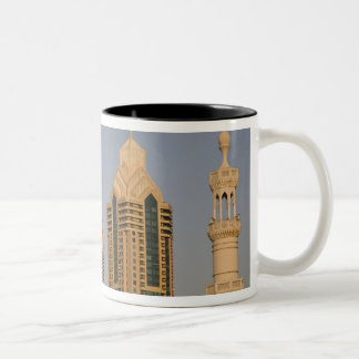 UAE, Dubai. Minaret of mosque in Al Wasl, with Coffee Mugs