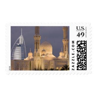 UAE, Dubai. Mosque in evening with Burj al Arab Postage Stamp