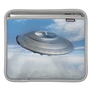 UFO flying through cloudy skies. iPad Sleeve