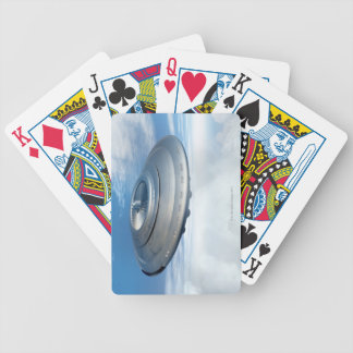 UFO flying through cloudy skies. Bicycle Playing Cards