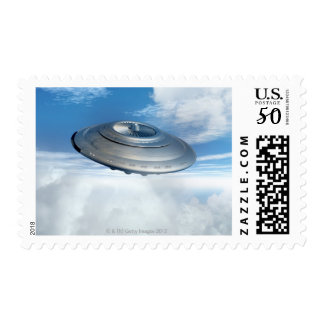 UFO flying through cloudy skies. Postage