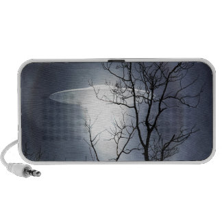 UFO with silhouetted tree branches Speaker