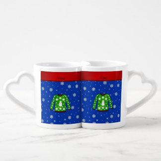 Ugly christmas sweater with green christmas backgr couples' coffee mug set