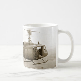 UH-1 Huey over Vietnam rice paddies mug