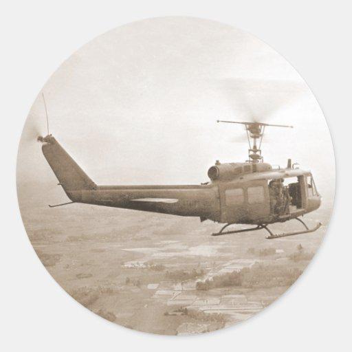 UH-1 Huey over Vietnam rice paddies sticker