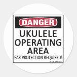 Ukulele del área de funcionamiento etiqueta redonda