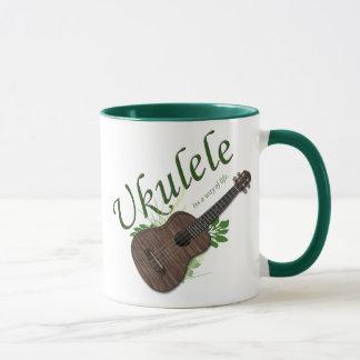 Ukulele-Su una manera de taza de la vida