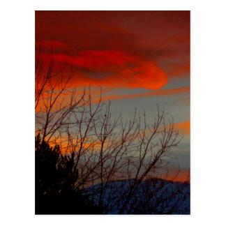 Última puesta del sol del invierno postales