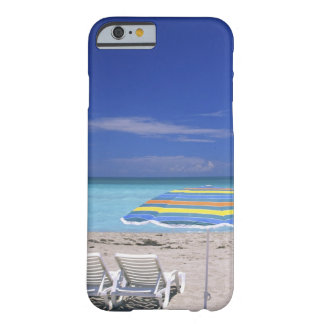 Umbrella and two lounge chairs on beach, Miami Barely There iPhone 6 Case