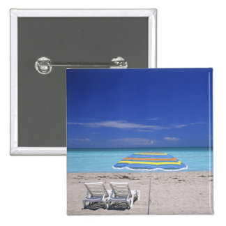 Umbrella and two lounge chairs on beach, Miami Button