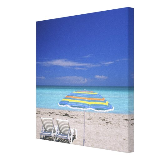Umbrella and two lounge chairs on beach, Miami Canvas Print