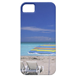 Umbrella and two lounge chairs on beach, Miami iPhone 5 Covers