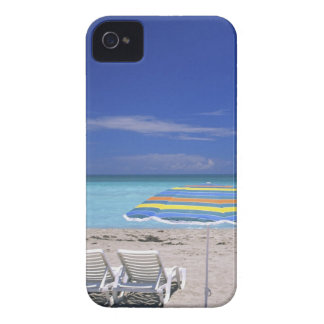 Umbrella and two lounge chairs on beach, Miami iPhone 4 Case-Mate Case