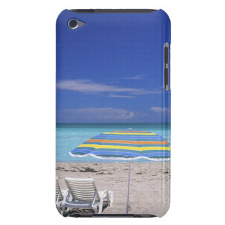 Umbrella and two lounge chairs on beach, Miami iPod Touch Cover
