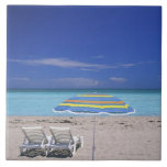 Umbrella and two lounge chairs on beach, Miami Large Square Tile