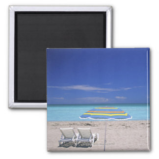 Umbrella and two lounge chairs on beach, Miami Magnet