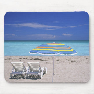 Umbrella and two lounge chairs on beach, Miami Mouse Pad