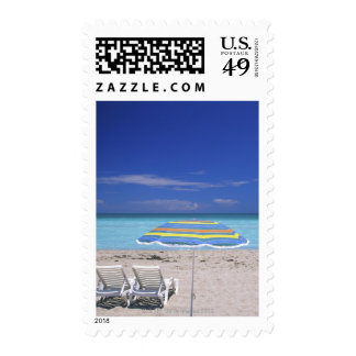 Umbrella and two lounge chairs on beach, Miami Stamps