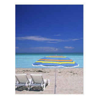 Umbrella and two lounge chairs on beach, Miami Postcard