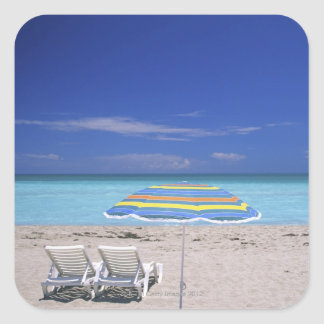 Umbrella and two lounge chairs on beach, Miami Square Sticker
