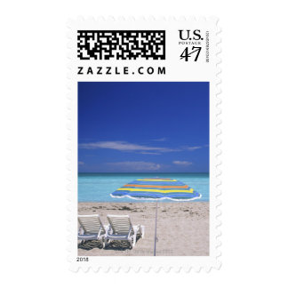 Umbrella and two lounge chairs on beach, Miami Stamp