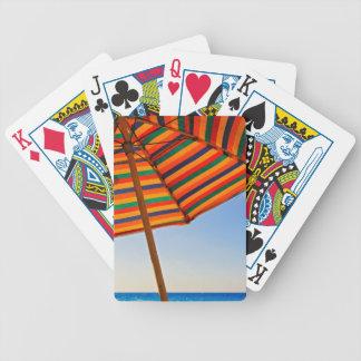 umbrella bicycle playing cards