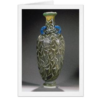 Un amphora corazón-formado con los adornos de la o tarjeta de felicitación