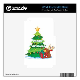 Un árbol de navidad grande al lado del reno que iPod touch 4G calcomanía