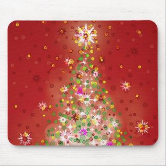 Un árbol de navidad que brilla intensamente tapete de raton