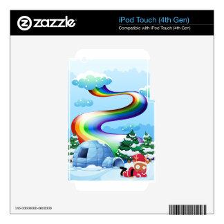Un arco iris sobre el iglú al lado del reno iPod touch 4G skin