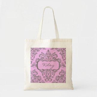 Un arsenal dulce de rosa y de gris bolsa lienzo