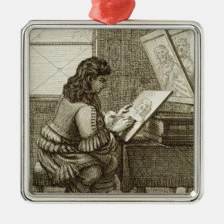 Un artista que copia sobre una placa del grabado, adorno navideño cuadrado de metal