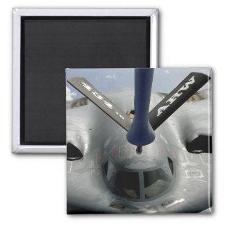 Un avión del alcohol B-2 que consigue en la Imán Cuadrado