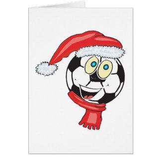 Un balón de fútbol de felices Navidad que lleva un Tarjeta De Felicitación