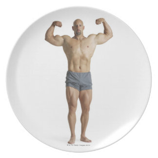 un bodybuilder masculino caucásico adulto platos para fiestas