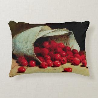 Un bolso derramado de cerezas