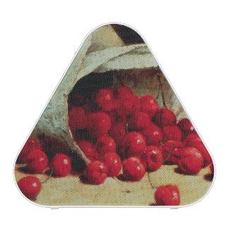 Un bolso derramado de cerezas altavoz