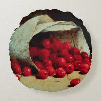 Un bolso derramado de cerezas cojín redondo