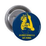 Un botón armado de la mujer pins