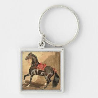 Un caballo árabe w c colocado en el papel llaveros personalizados
