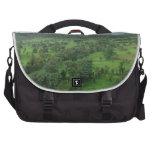 Un campo verde hermoso bolsa de ordenador