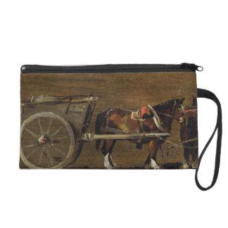 Un carro de la granja con dos caballos en arnés U