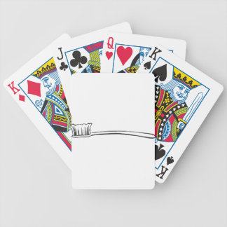 Un cepillo del cuarto de baño baraja cartas de poker