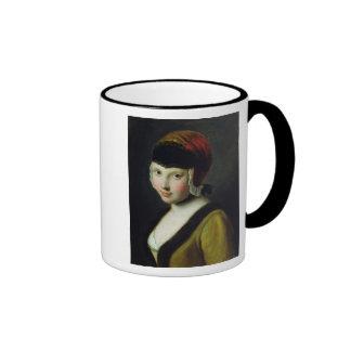 Un chica con una máscara negra tazas de café