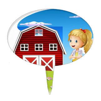 Un chica delante del barnhouse rojo en el hillto palillos de tarta
