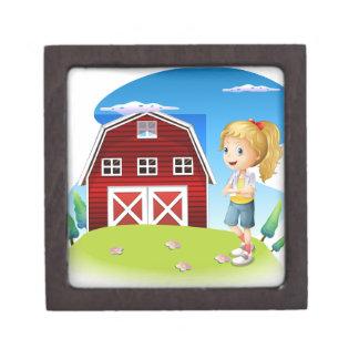 Un chica delante del barnhouse rojo en el hillto caja de regalo de calidad