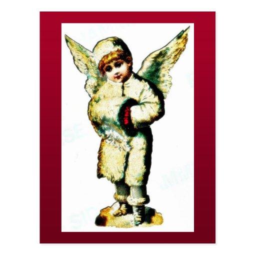 Un chica vestido como un ángel que ruega tarjetas postales