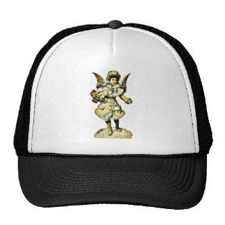 Un chica vestido como un ángel tiene mano por comp gorra